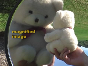 magnified_teddy_bear_image_concave_mirror